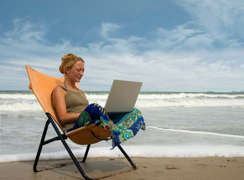 Small Business Owner Working Remotely While on Vacation